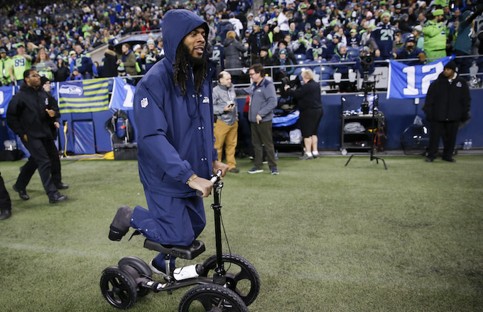 Richard Sherman wheels around the sidelines before the game against the Philadelphia Eagles.