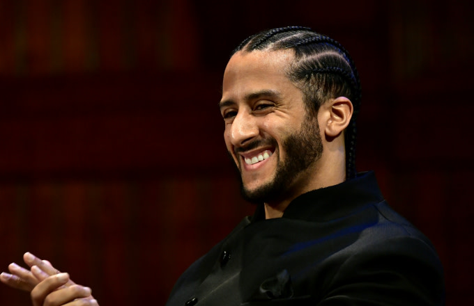 Colin Kaepernick on stage at the W.E.B. Du Bois Medal Award Ceremony