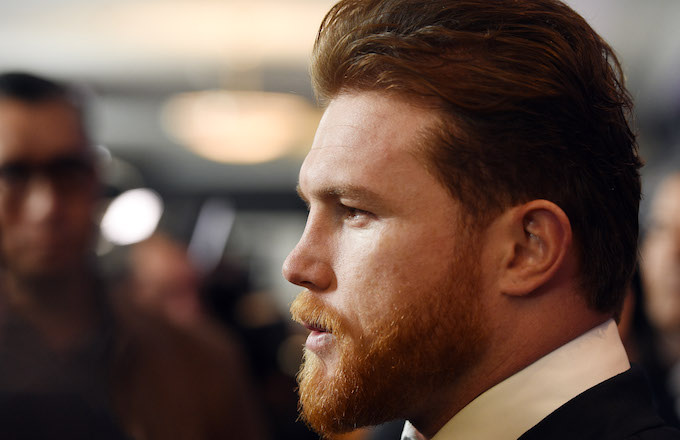 Canelo Alvarez poses during a news conference.