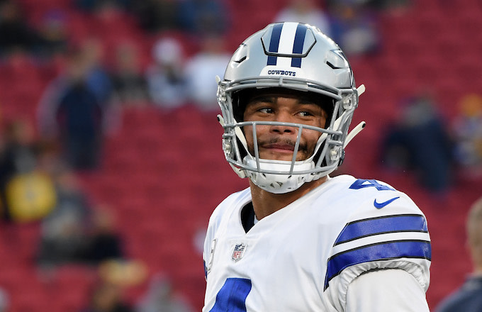 Dak Prescott warms up before the NFC Divisional Playoff game against the Los Angeles Rams.