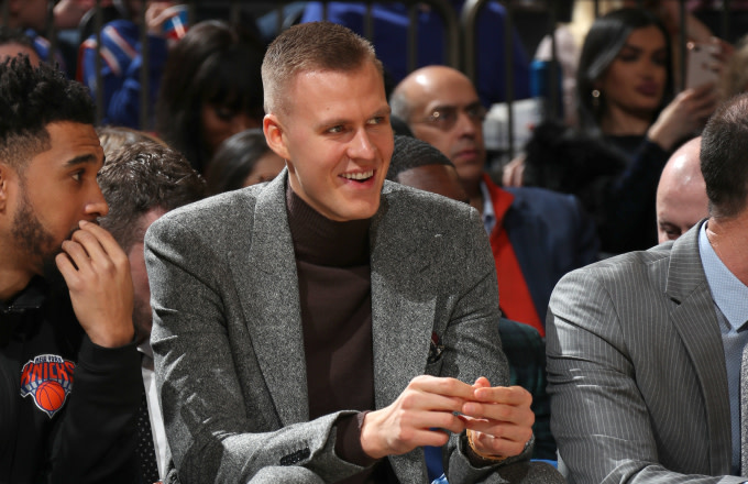 Kristaps Porzingis #6 of the New York Knicks smiles during the game