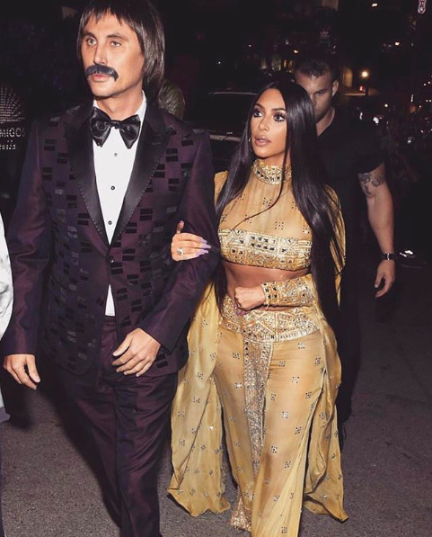 Jonathan Cheban (left) and Kim Kardshian (right) dressed as Sonny and Cher for Halloween