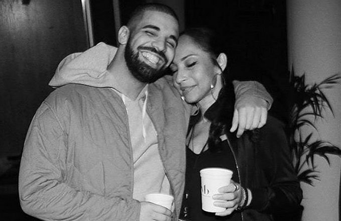 Drake smiles for an Instagram picture with Sade.