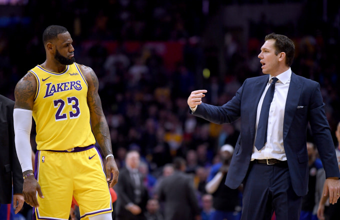 LeBron James #23 of the Los Angeles Lakers and Luke Walton talk