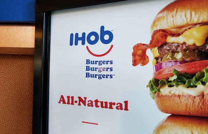 Close-up of sign with IHoB (International House of Burgers) logo.