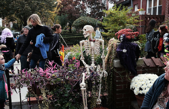 People trick-or-treat in a Brooklyn neighborhood on Halloween night.