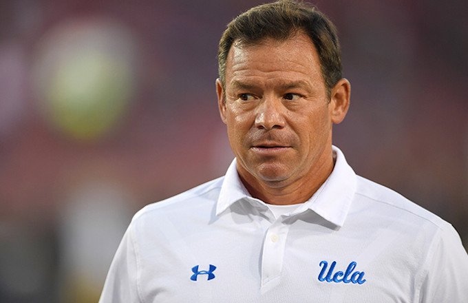 Jim Mora watches warmups before game against Stanford.