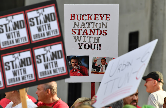 Supporters of Ohio State head football coach Urban Meyer.