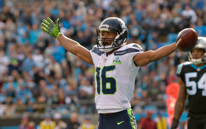 Tyler Lockett #16 of the Seattle Seahawks celebrates a touchdown against the Carolina Panthers