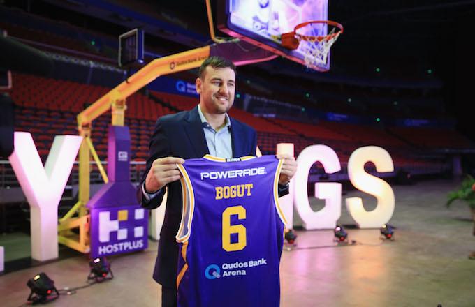Andrew Bogut holds up a Kings singlet.
