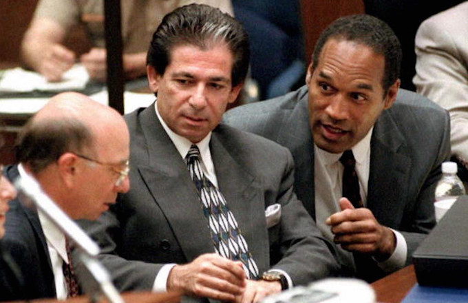 O.J. Simpson (R) consulting with friend Robert Kardashian