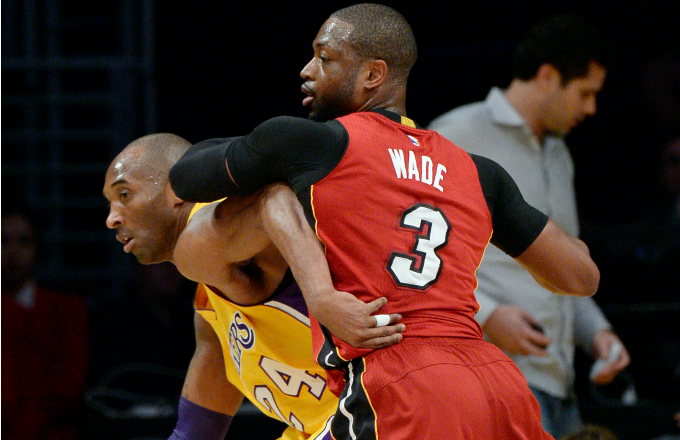 Kobe Bryant #24 of the Los Angeles Lakers is defended by Dwyane Wade