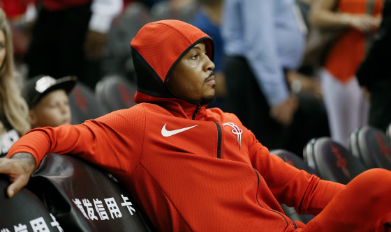 Carmelo Anthony #7 of the Houston Rockets looks on from the bench