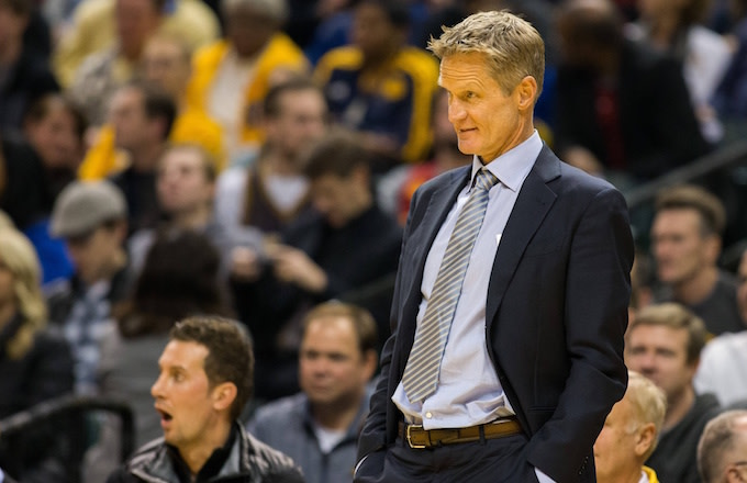 Steve Kerr roams the Warriors sidelines, watches team play.