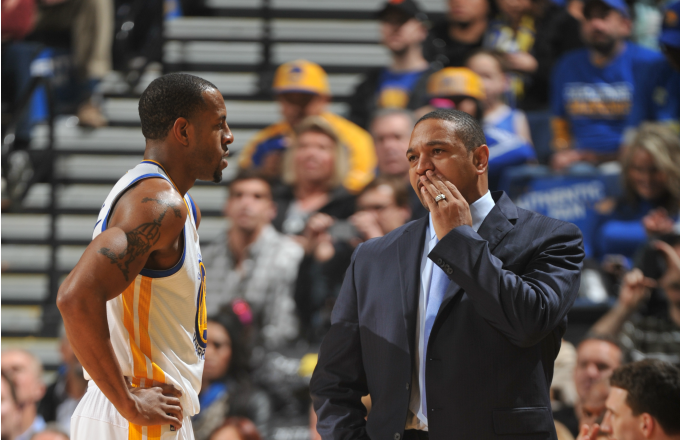 Head Coach Mark Jackson of the Golden State Warriors coaches player Andre Iguodala