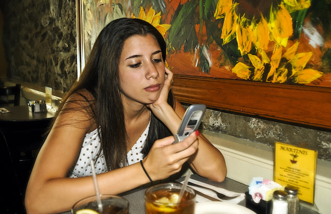 Teenager with a flip phone in 2006.
