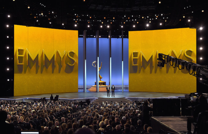 Colin Jost (L) and Michael Che speak onstage during the 70th Emmy Awards.