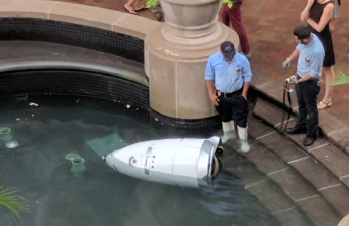 Security Robot goes into fountain.