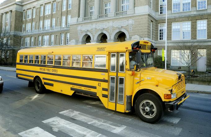 A school bus passes by Portland High School