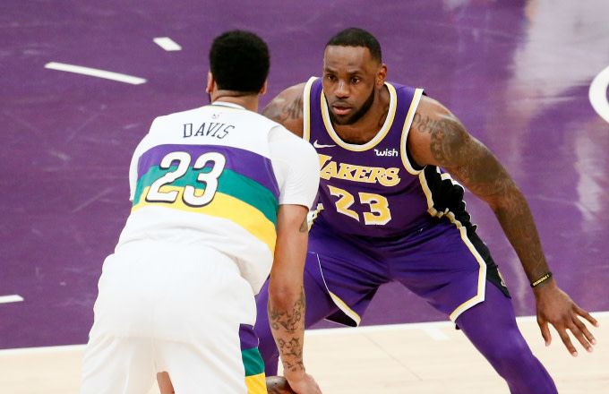 9daf2e3e LeBron James #23 of the Los Angeles Lakers plays defense against Anthony  Davis