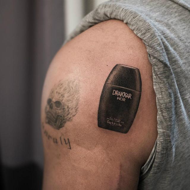 Drake's Drakkar Noir tattoo
