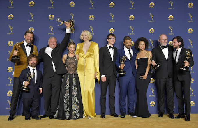 George RR Martin and the cast of Game of Thrones pose with the Emmy for Outstanding Drama Series.
