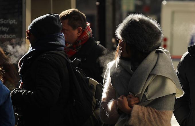 People walk through a frigid Manhattan