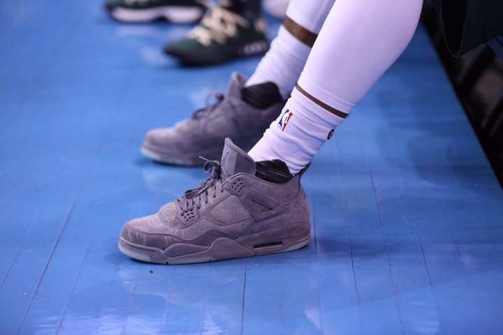 Milwaukee Bucks rookie Gary Payton II sports KAWS Air Jordan IVs against the Oklahoma City Thunder.