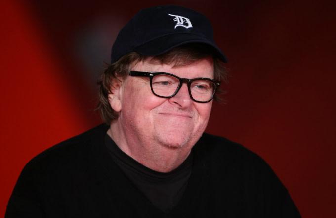 Michael Moore walks the red carpet