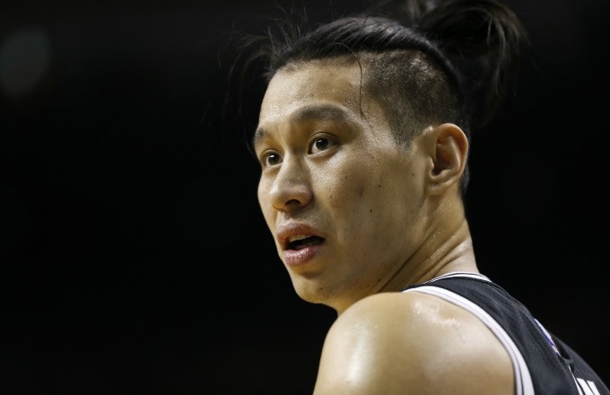 Jeremy Lin reacts to a call during a Nets game.