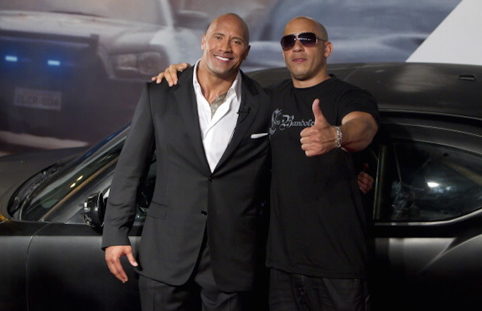 Dwayne Johnson (The Rock) and Vin Diesel (R) pose for photographers