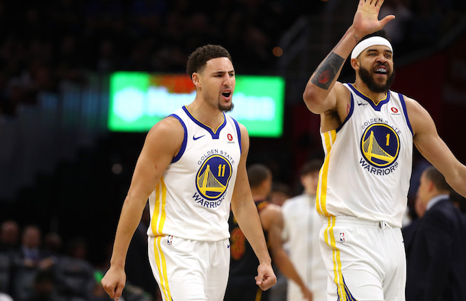 Klay Thompson #11 and JaVale McGee #1 of the Golden State Warriors.
