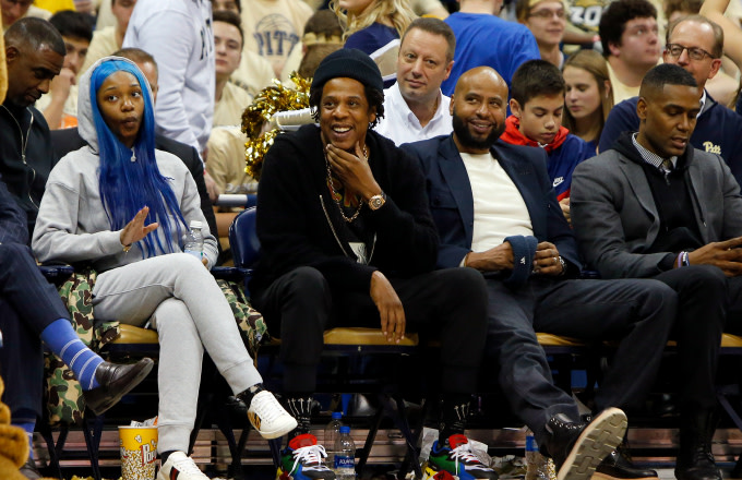 Jay-Z laughs during the game between the Pittsburgh Panthers and the Duke Blue Devils