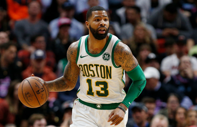 Marcus Morris #13 of the Boston Celtics dribbles with the ball against the Miami Heat