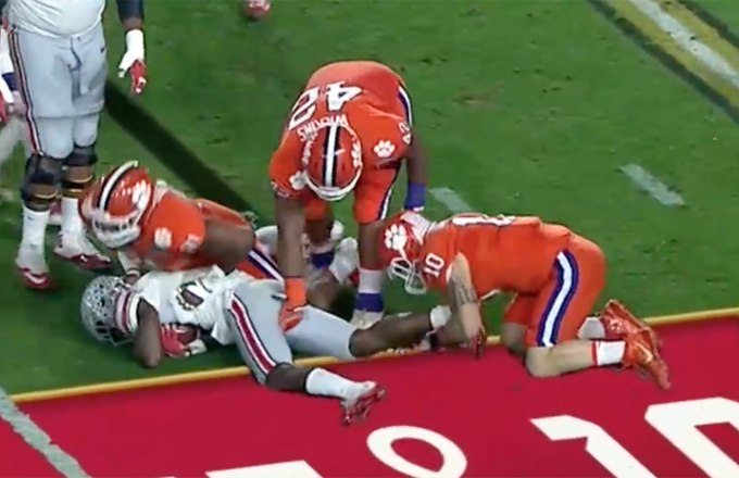 Christian Wilkins grabs Curtis Samuel.