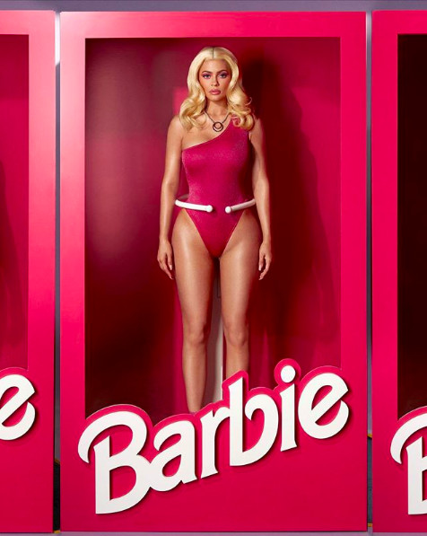 Kylie Jenner dressed as Barbie in a one-shoulder pink bodysuit and blonde wig for Halloween