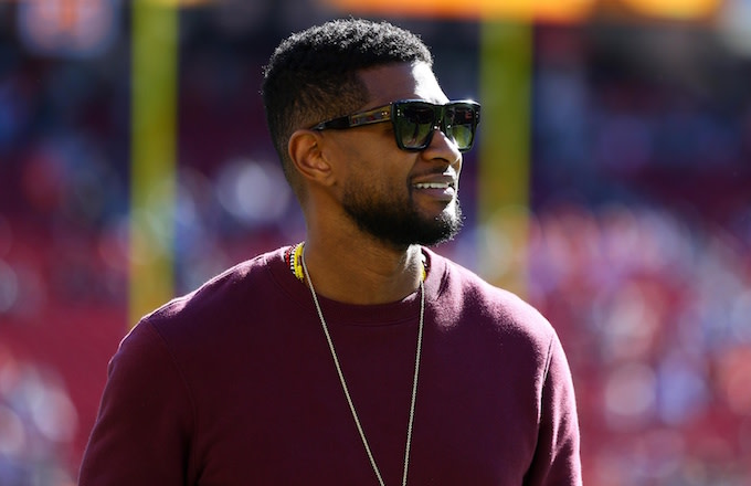 Usher on the field before Super Bowl 50.