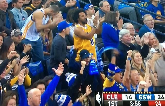 Warriors fan in a Kobe Bryant jersey.