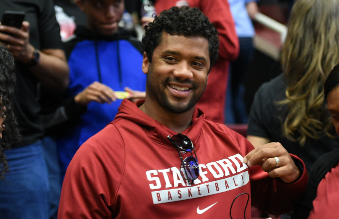 Russell Wilson celebrates after the Cardinals win