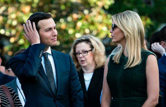 Jared Kushner and Ivanka Trump wait on the South Lawn of the White House.