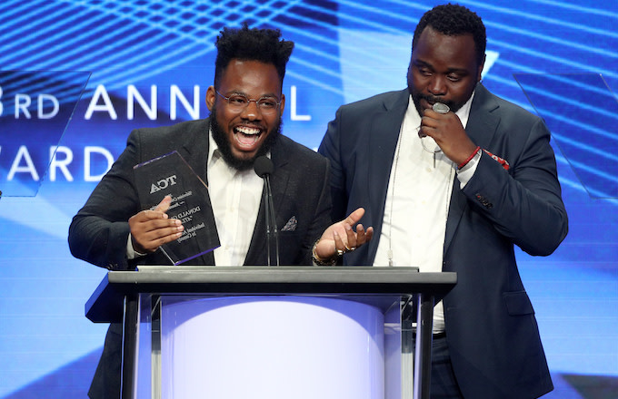 Stephen Glover and actor Brian Tyree Henry accept the award for 'Individual Achievement in Comedy.'