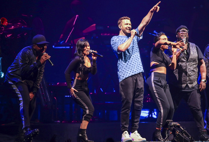 Justin Timberlake performing at a concert.