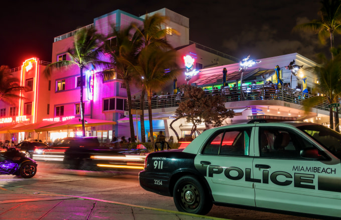 Florida, Miami Beach, Wet Willie's at night with Police Cruiser