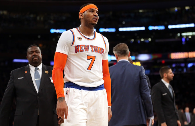 Carmelo Anthony walks off the court in disgust.