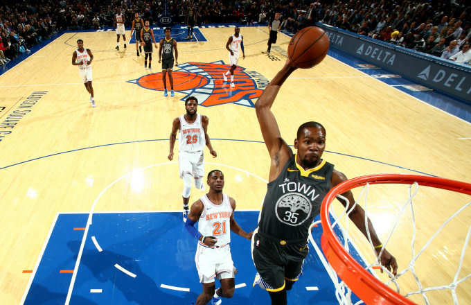 Kevin Durant #35 of the Golden State Warriors dunks the ball
