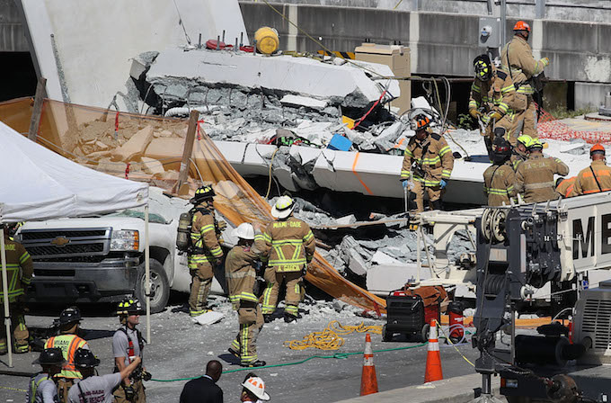 Firefighters at Miami bridge collapse