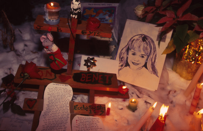 People light candles at the murder site of 6-year-old Jonbenet Ramsey.