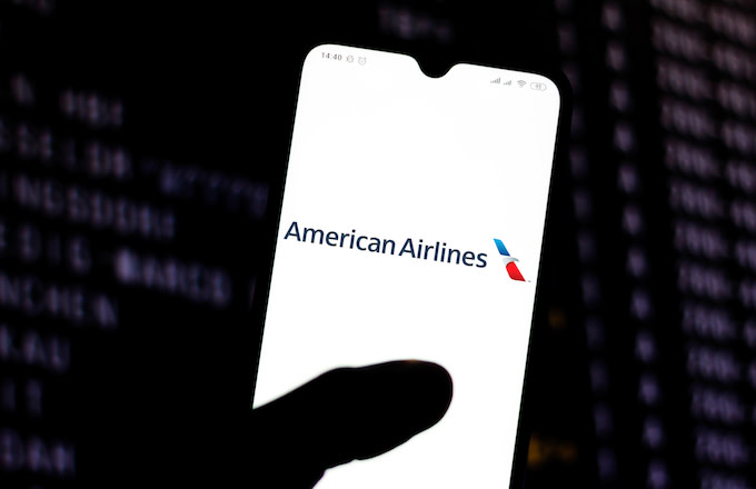 American Airlines logo is seen displayed on a smartphone.