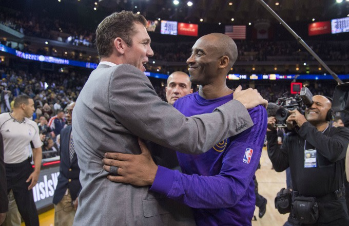 Luke Walton and Kobe Bryant embrace after a game.
