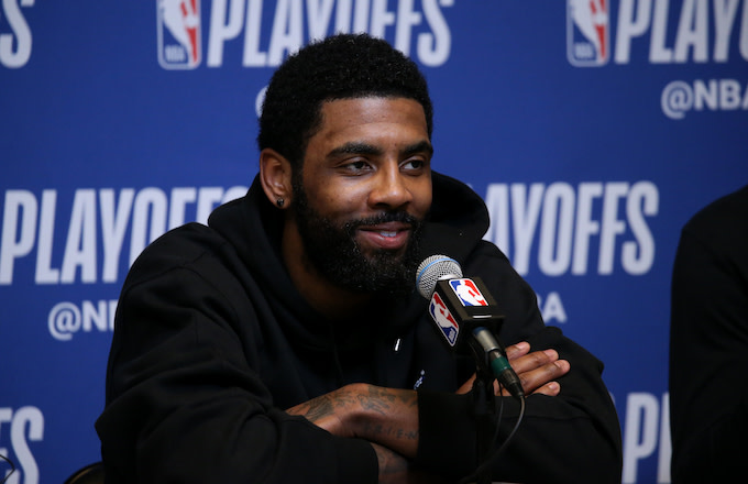 Kyrie Irving smiles at the press conference after Game One of the Eastern Conference Semifinals.